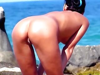 Smooth-shaven Cooters With Wonderful Bums On The Beach