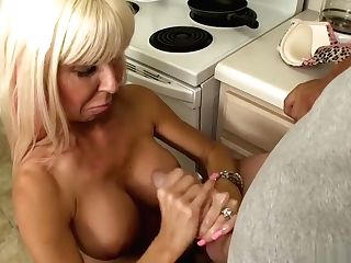 Horny Blonde Mummy With Nice Tits Tempts A Tubby Boy With A Kitchen Hand Jobs